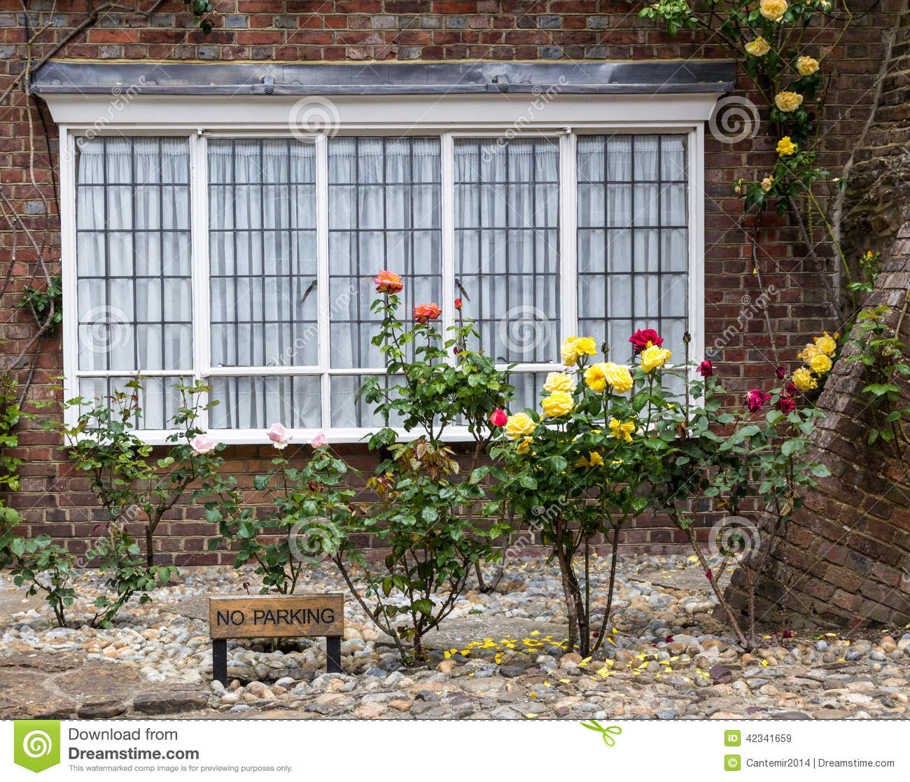 A brick house with roses on the front porch seen in rye kent