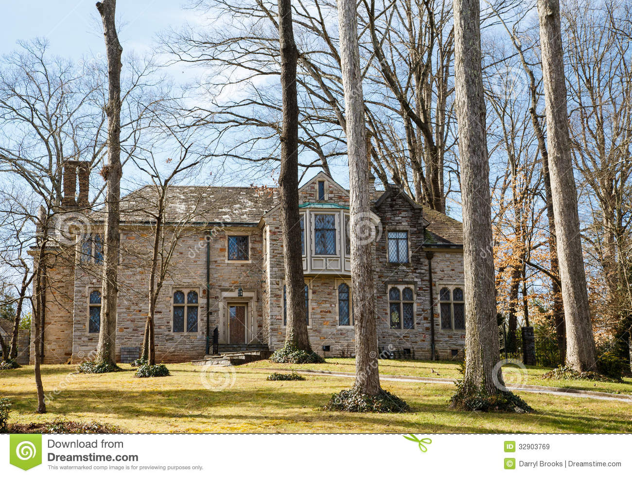 Brick Mansion In Trees With Slate Roof