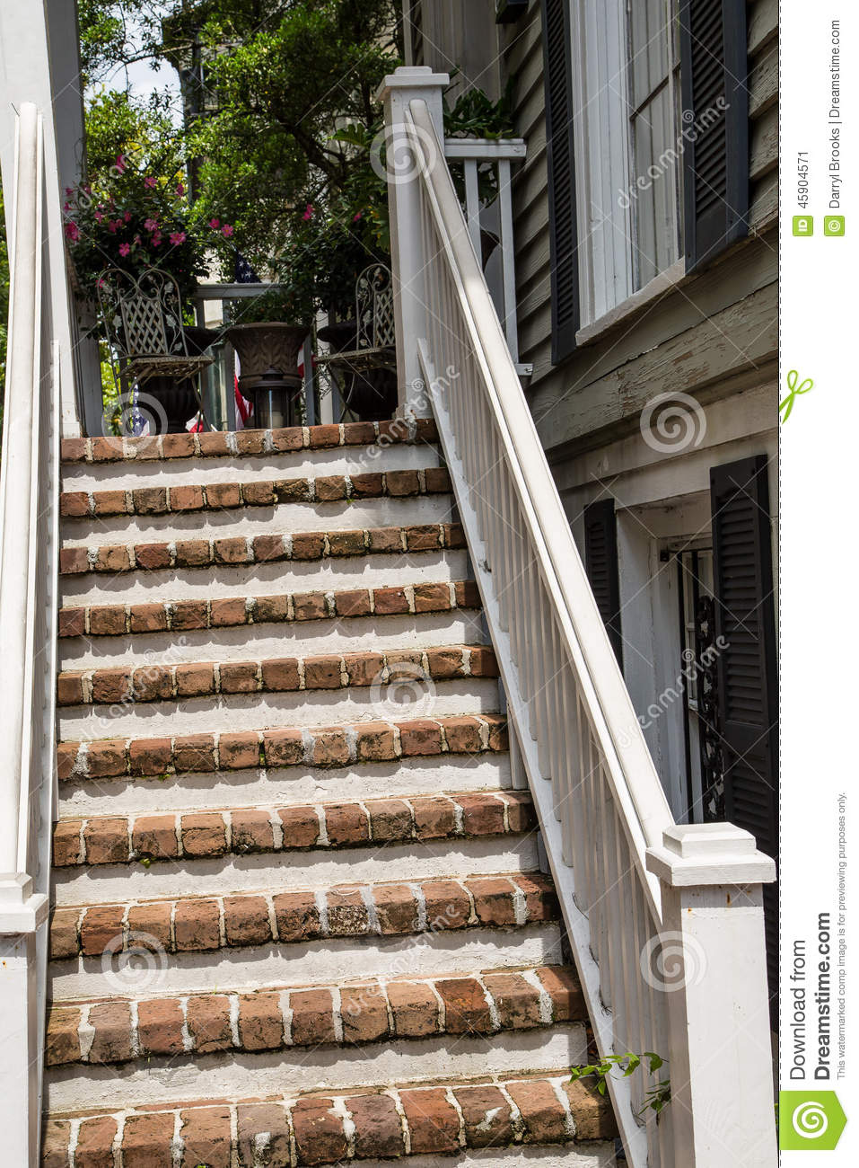 Brick and mortar steps up old wood porch stock photo for Steps in building a home