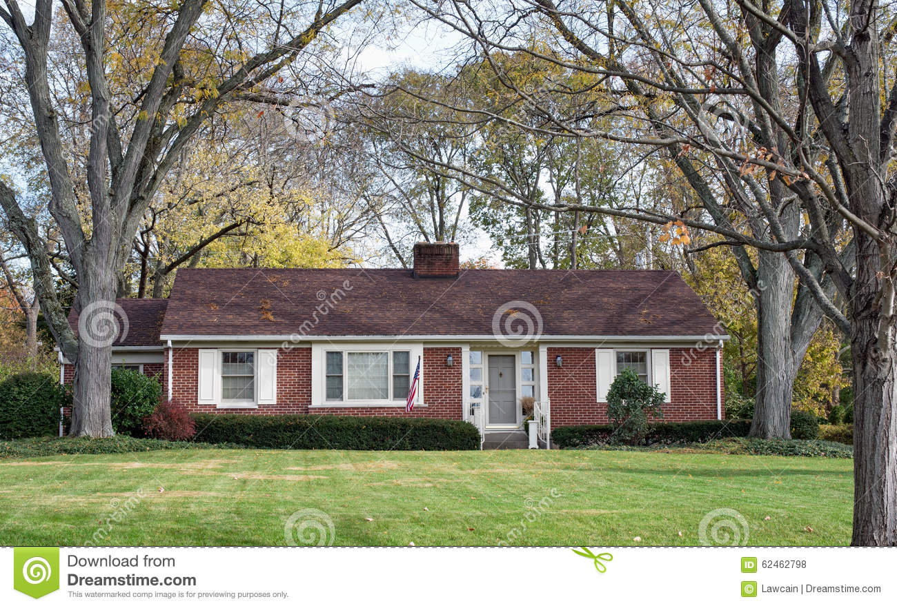 Brick ranch house in wooded setting stock photo image for Single story brick house plans