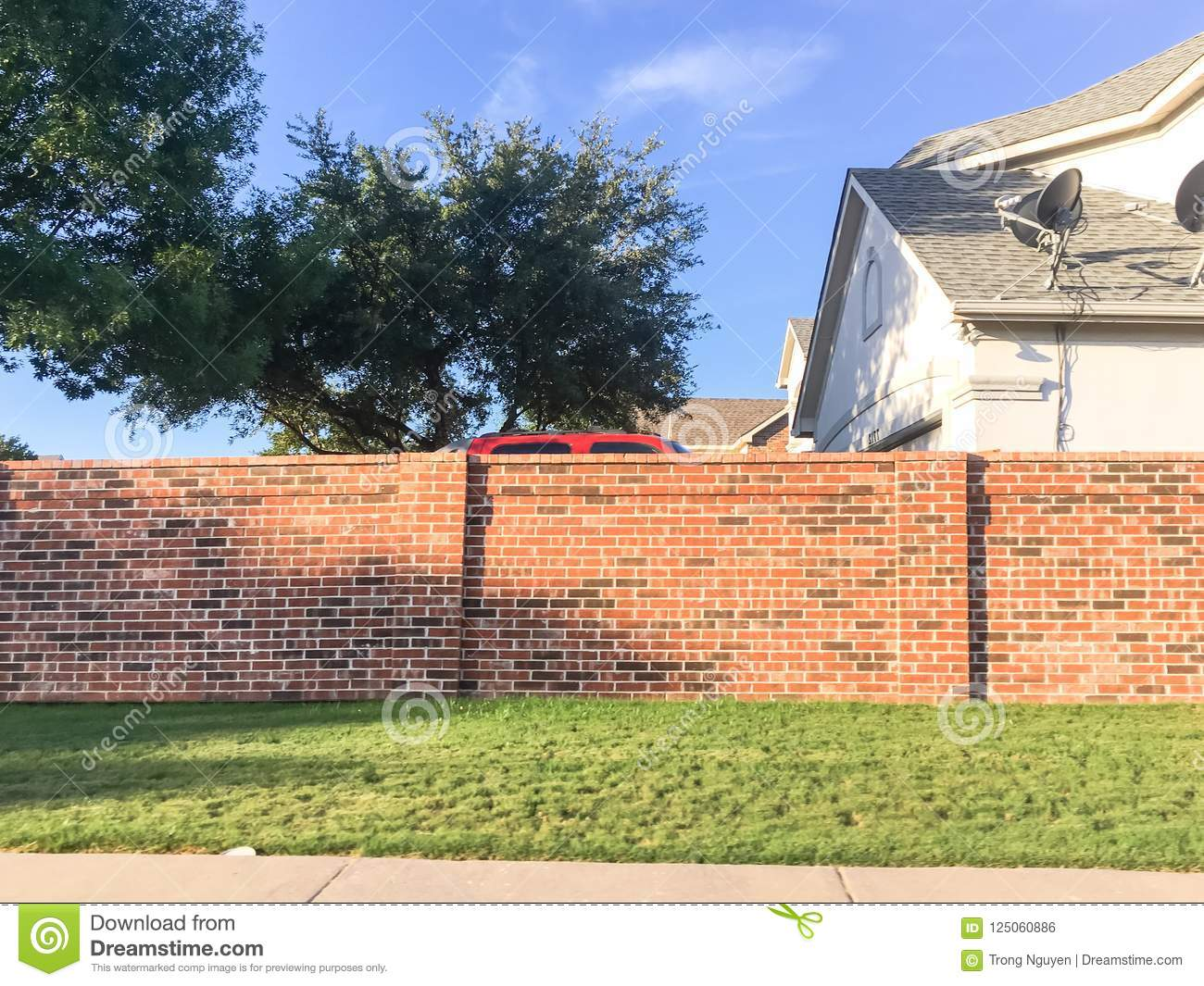 Brick sound walls residential houses with satellite tv in Dallas