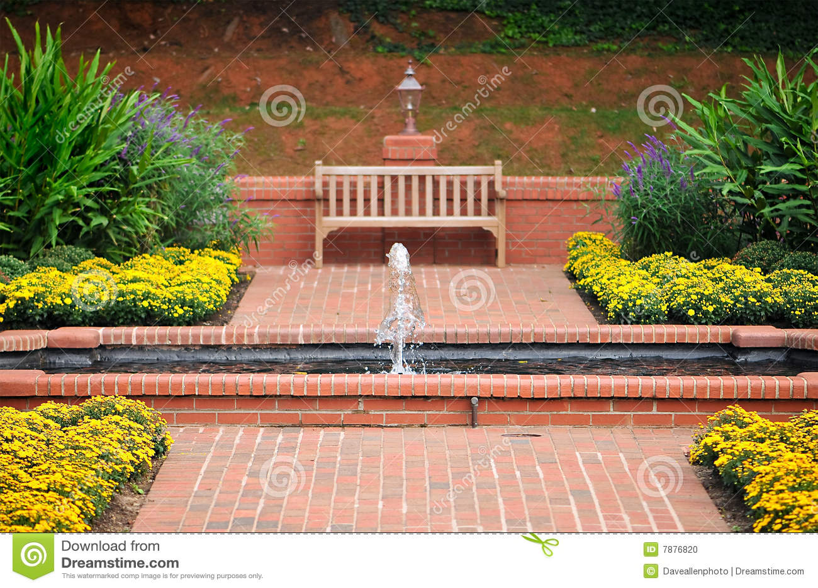 Brick Walkway And Garden Water Fountain Bench Stock Photo
