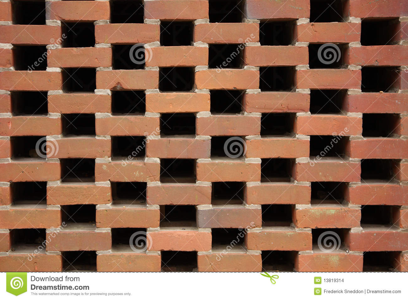 Honeycomb Brick Work : Brick wall built by honeycomb bond method stock photo