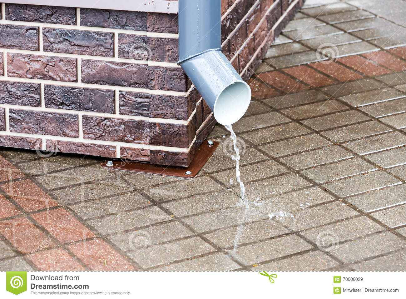 Brick wall with a drainpipe in rain stock image image of for Water pipe outside house