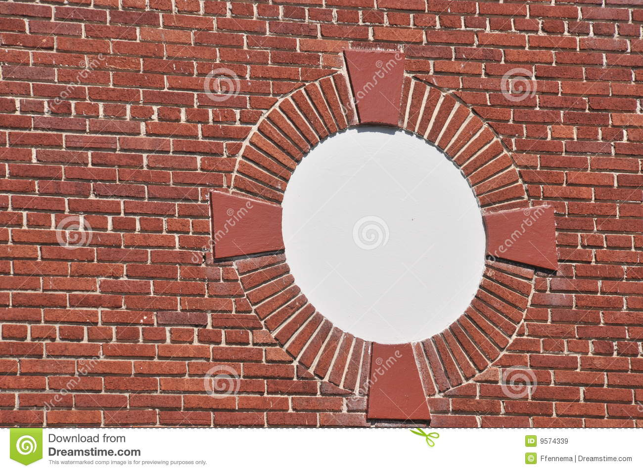 brick wall with ornate circle design royalty free stock