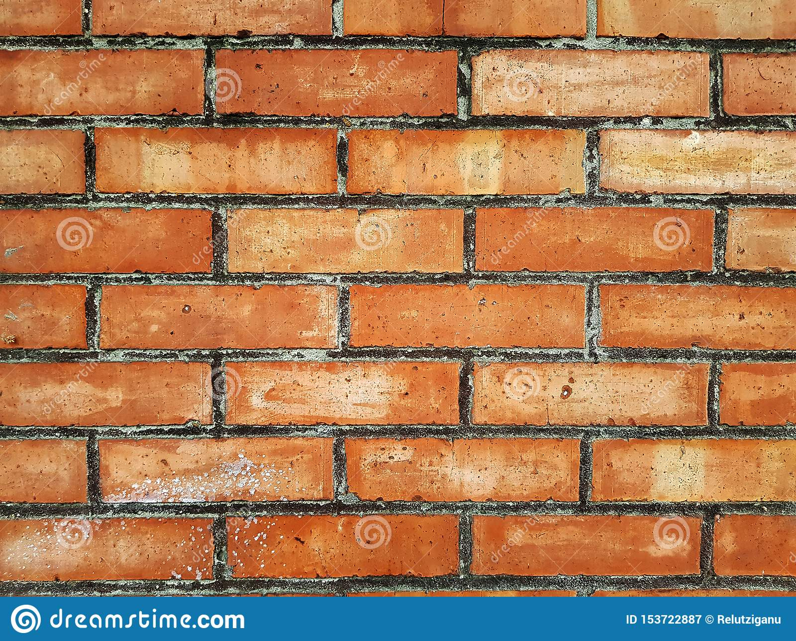 The brick wall of red color, wide panorama of masonry. Background of old vintage brick wall