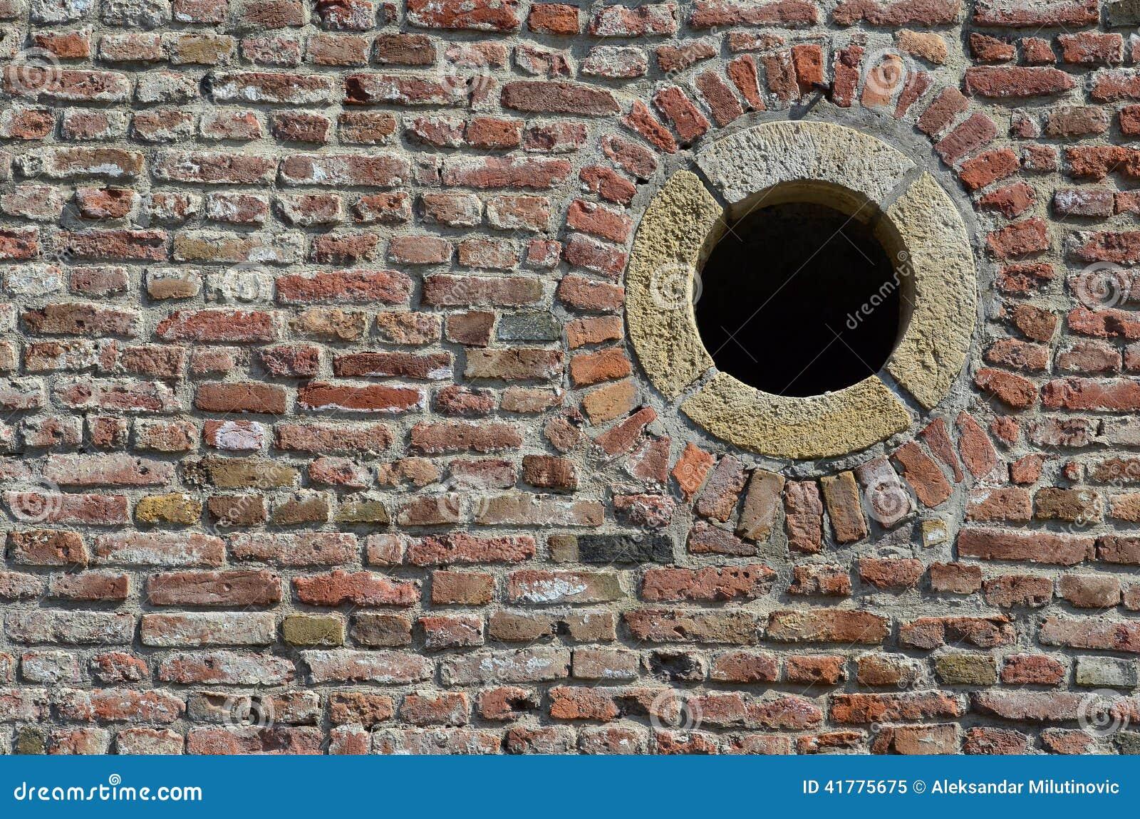 Brick wall and round hole