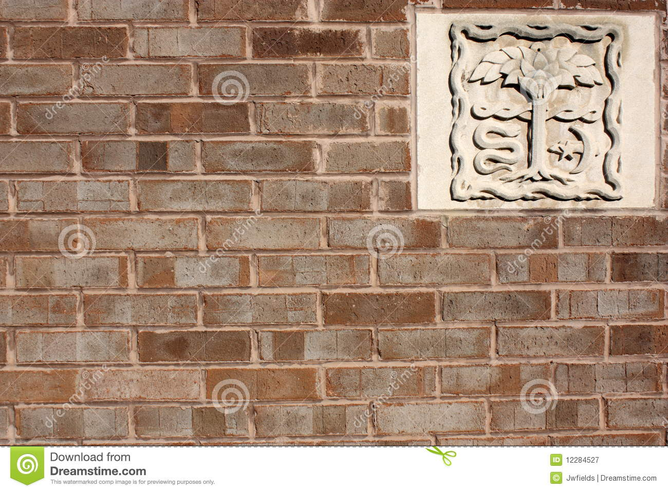 Brick wall with stone carving royalty free stock