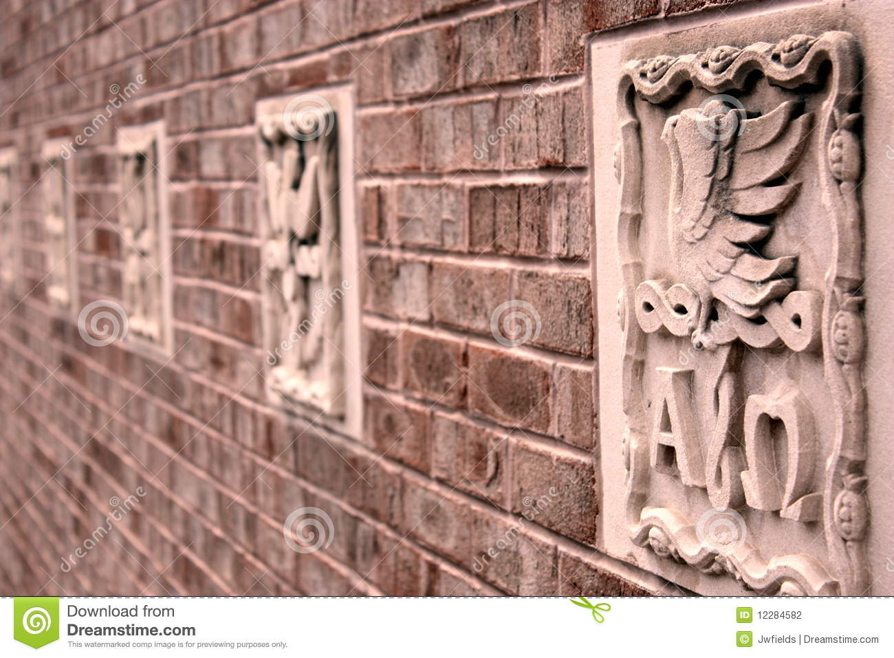 Brick wall with stone carvings stock photography image