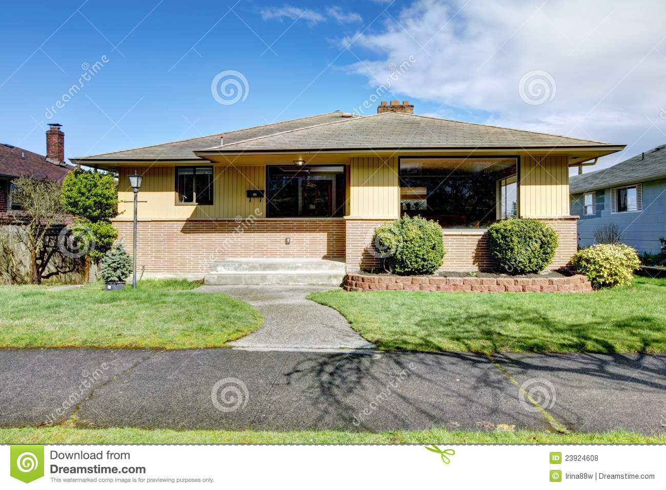 Brick yellow american rambler house royalty free stock for Rambler homes