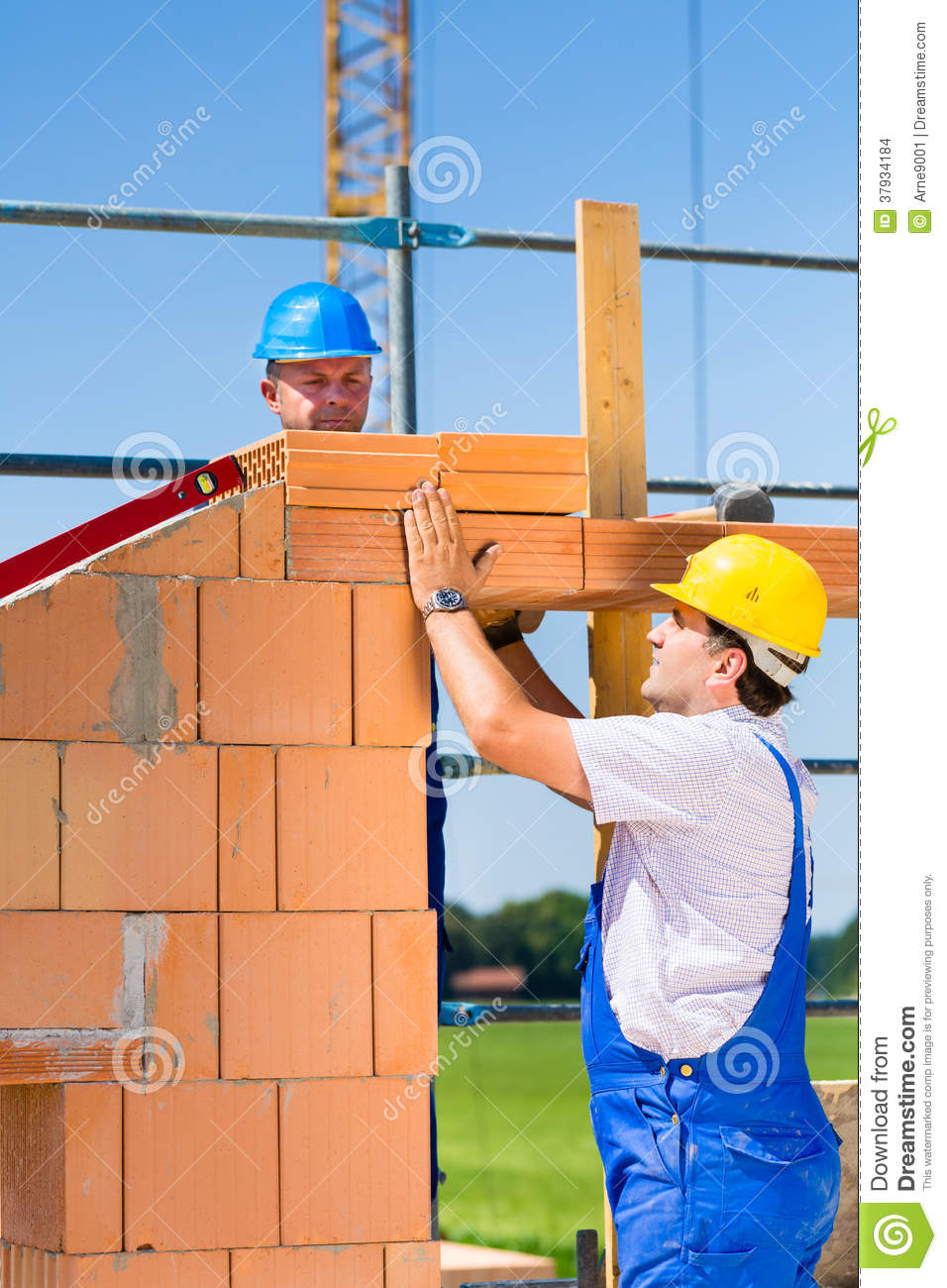 Bricklayer Or Builders On Construction Site Working Stock