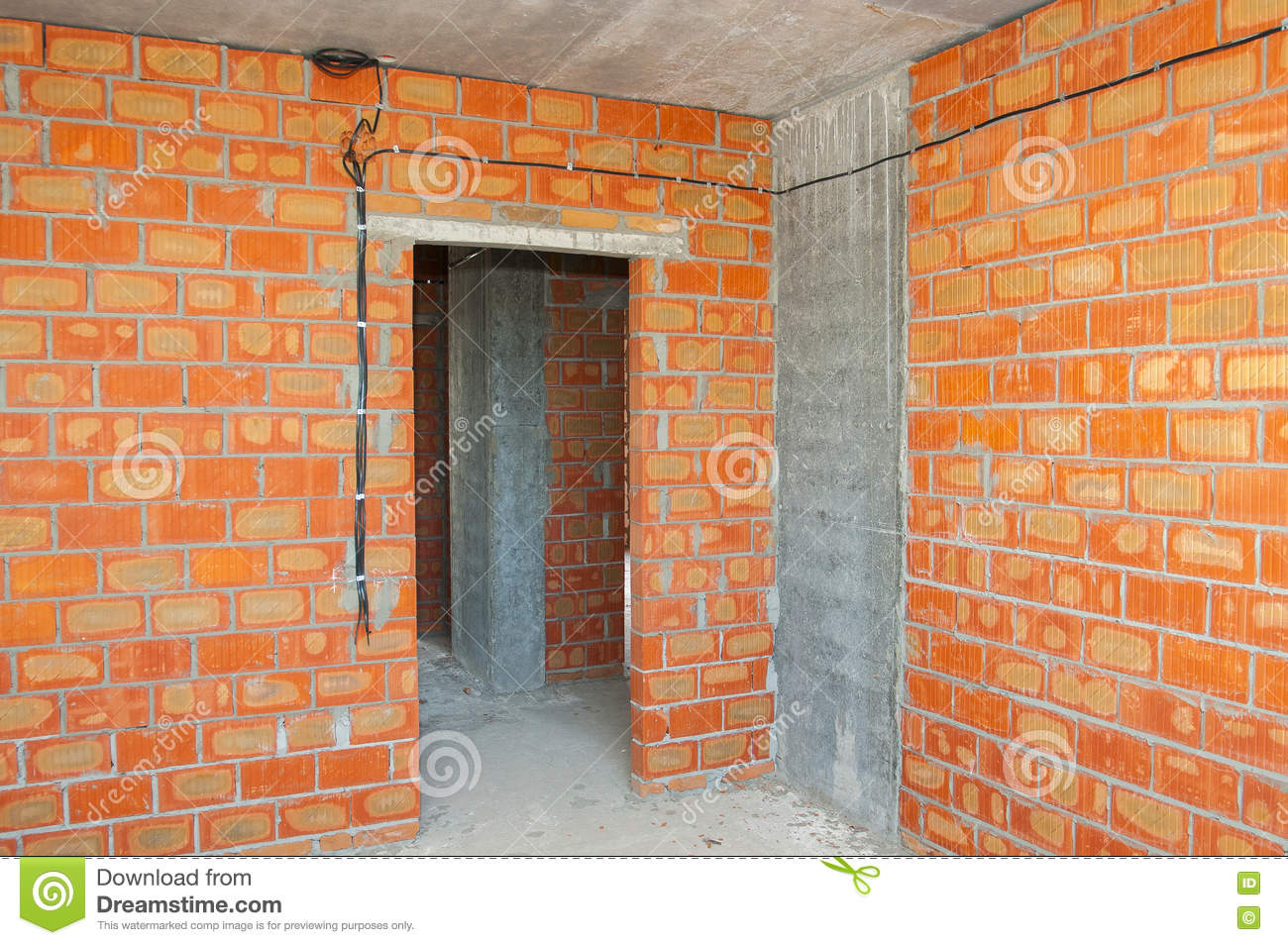 Bricklayer building new house with brick walls, interior rooms,wiring