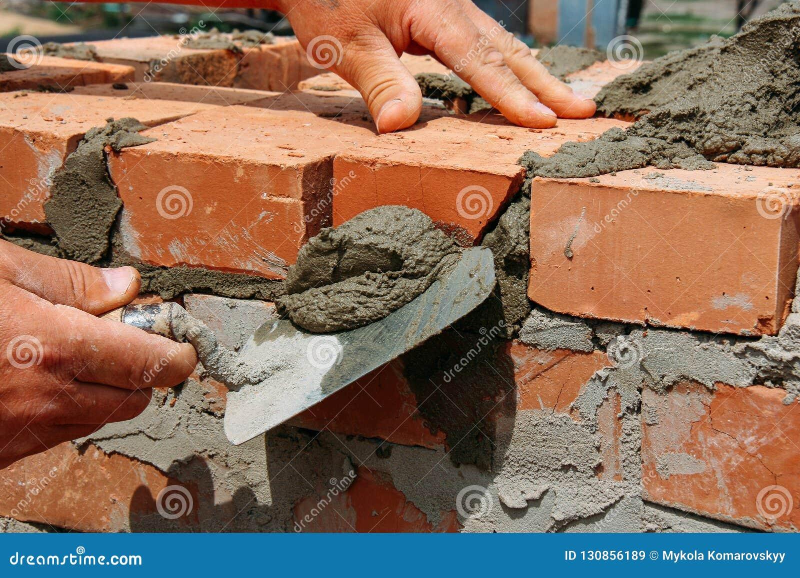 Bricklayer Installing Bricks Stock Image - Image of masonry