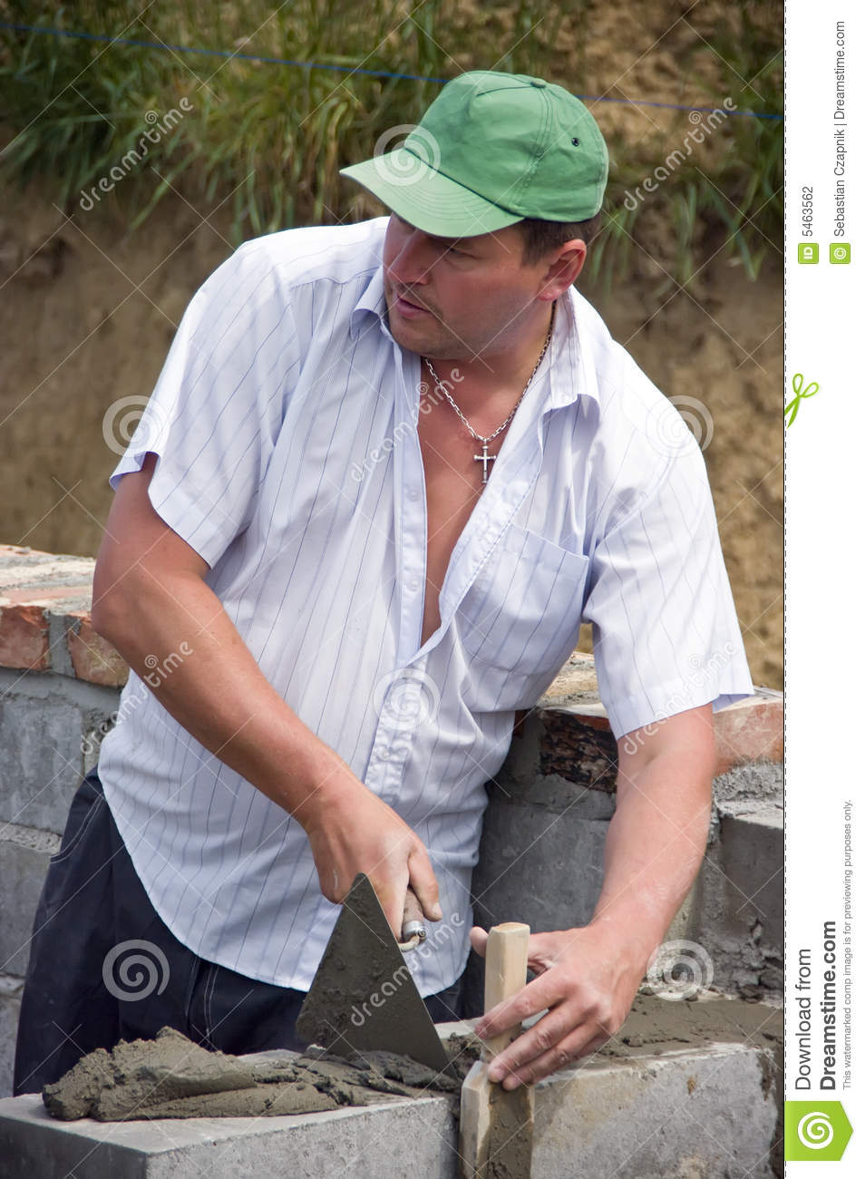 House builder bricklayer at work he is laying another block and