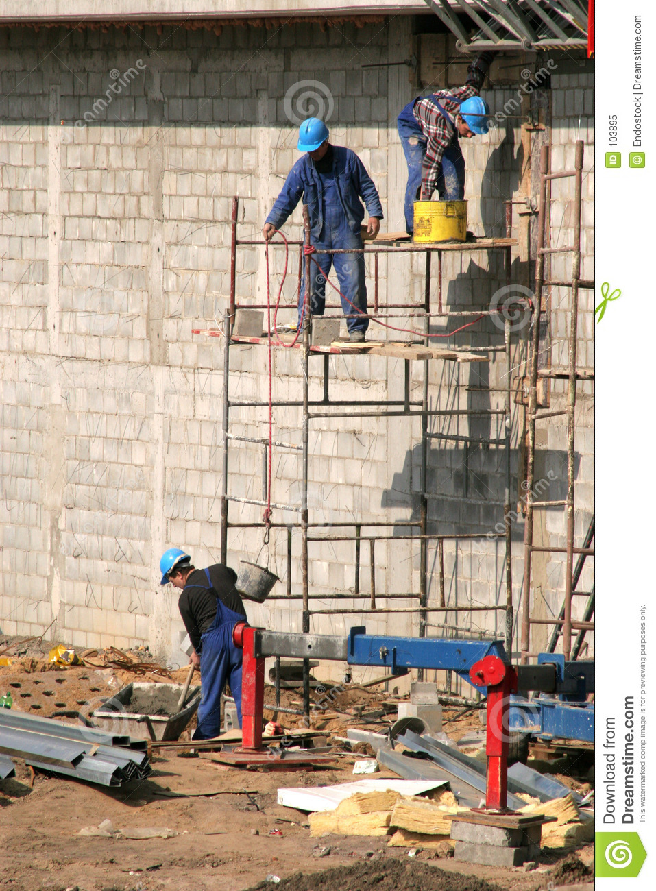Bricklayers on scaffolding