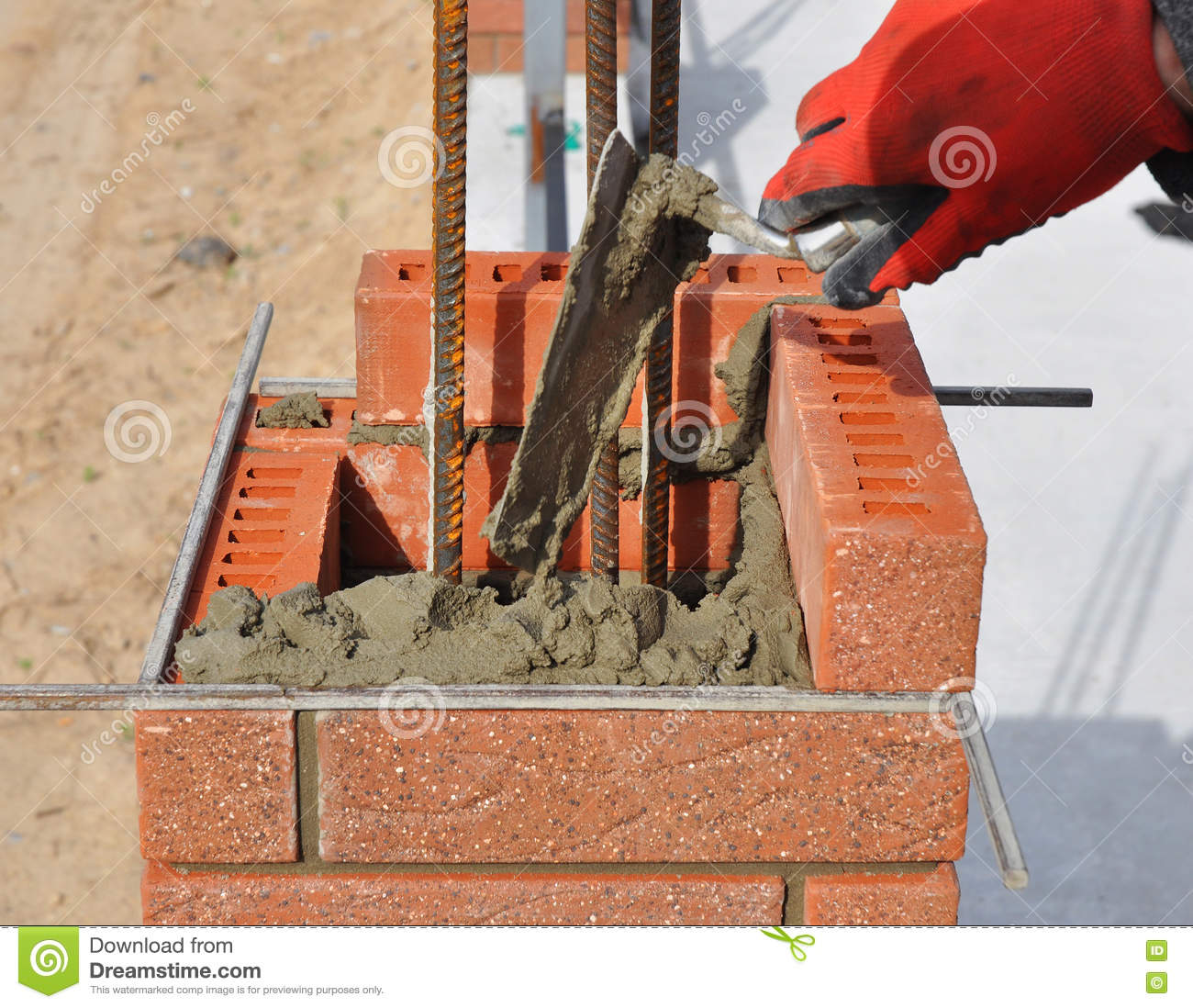 Brick Fence Construction : Bricklaying closeup bricklayer hand holding a putty knife