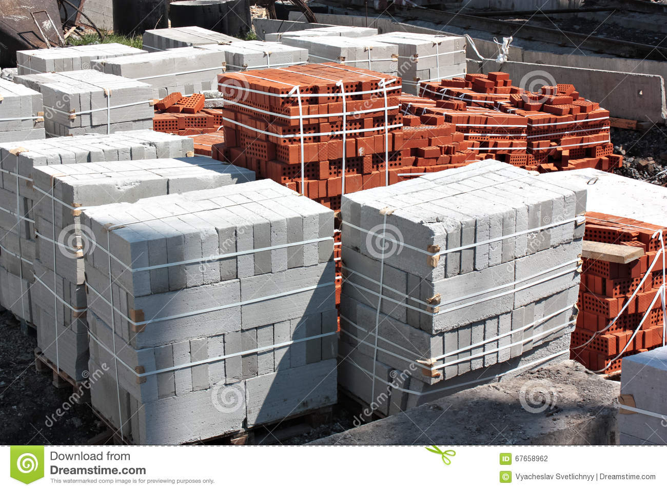 Bricks and concrete blocks on a building site stock photo for Cinder block house construction