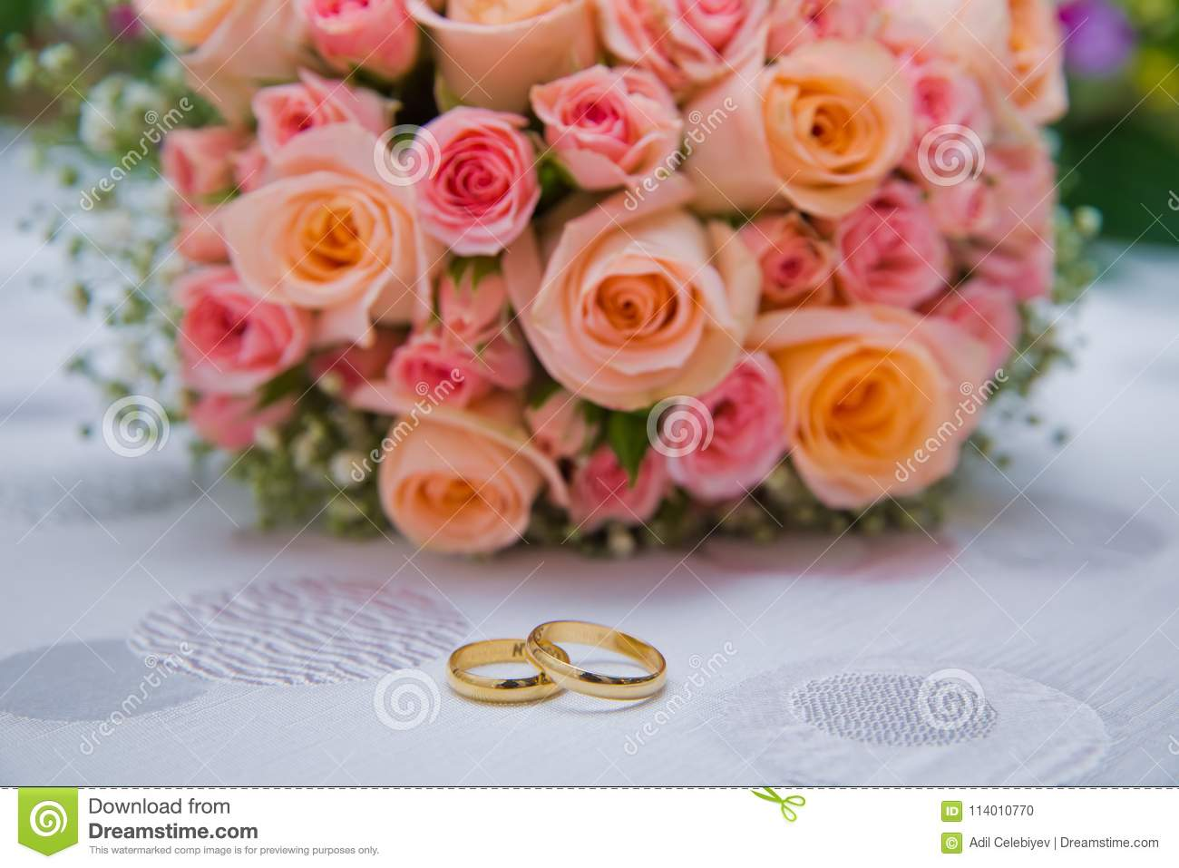 Bridal Bouquet With Orange And Pink Roses Of Different Size With