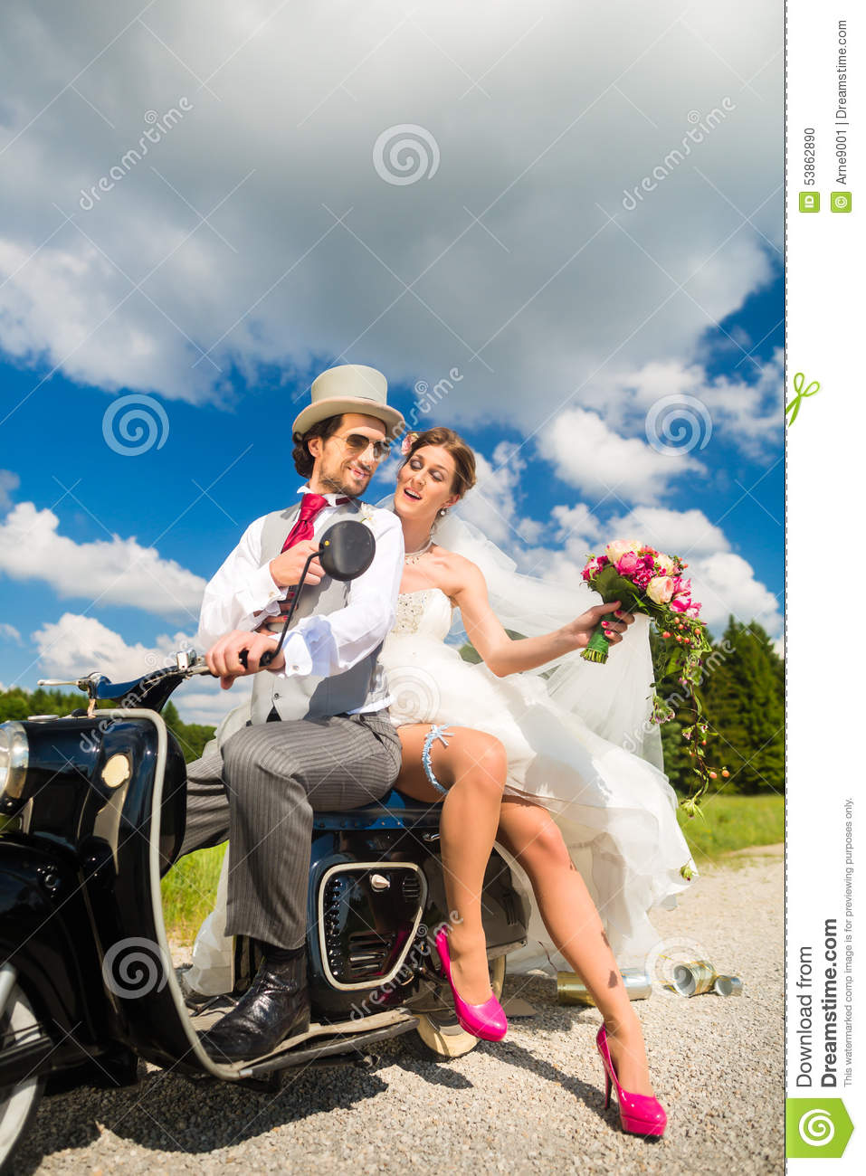 Bridal Couple Driving Motor Scooter Wearing Gown And Suit Stock ...