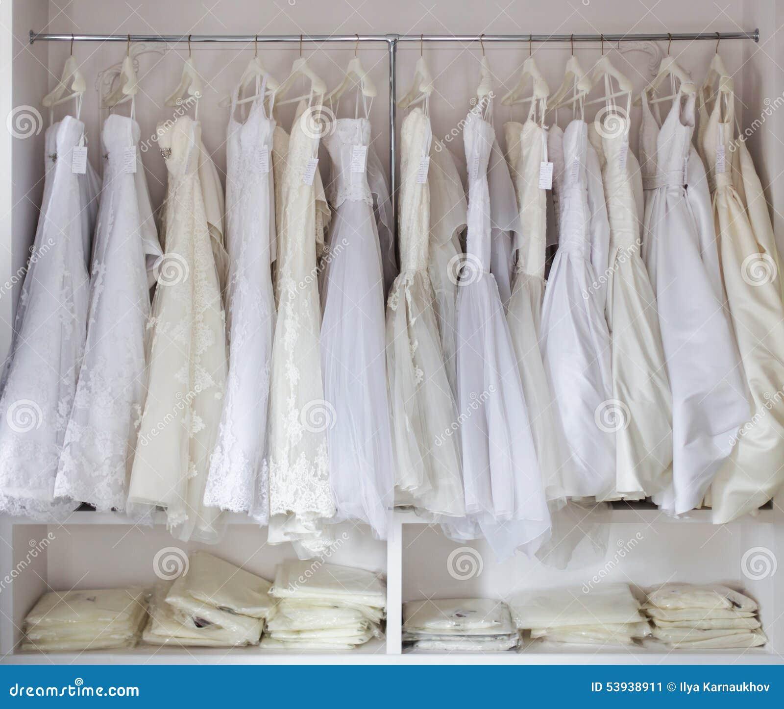 White Wedding Dress Hanger: Bridal Store Stock Photo
