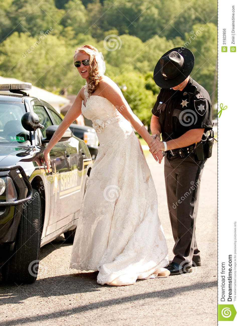 a bride is arrested on her wedding day royalty free stock