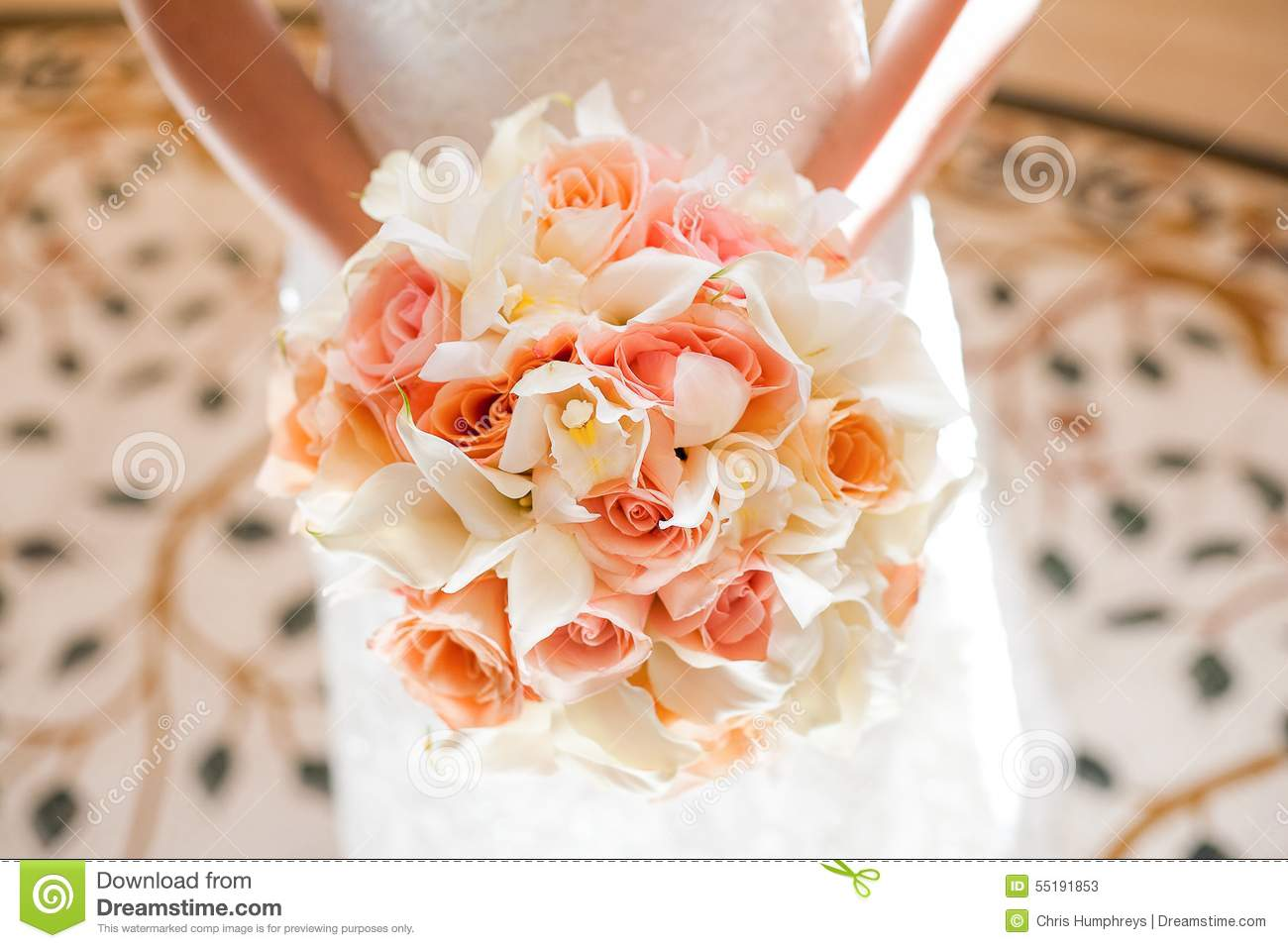 Bride With Beautiful Orange And Pink Wedding Bouquet Of Flowers