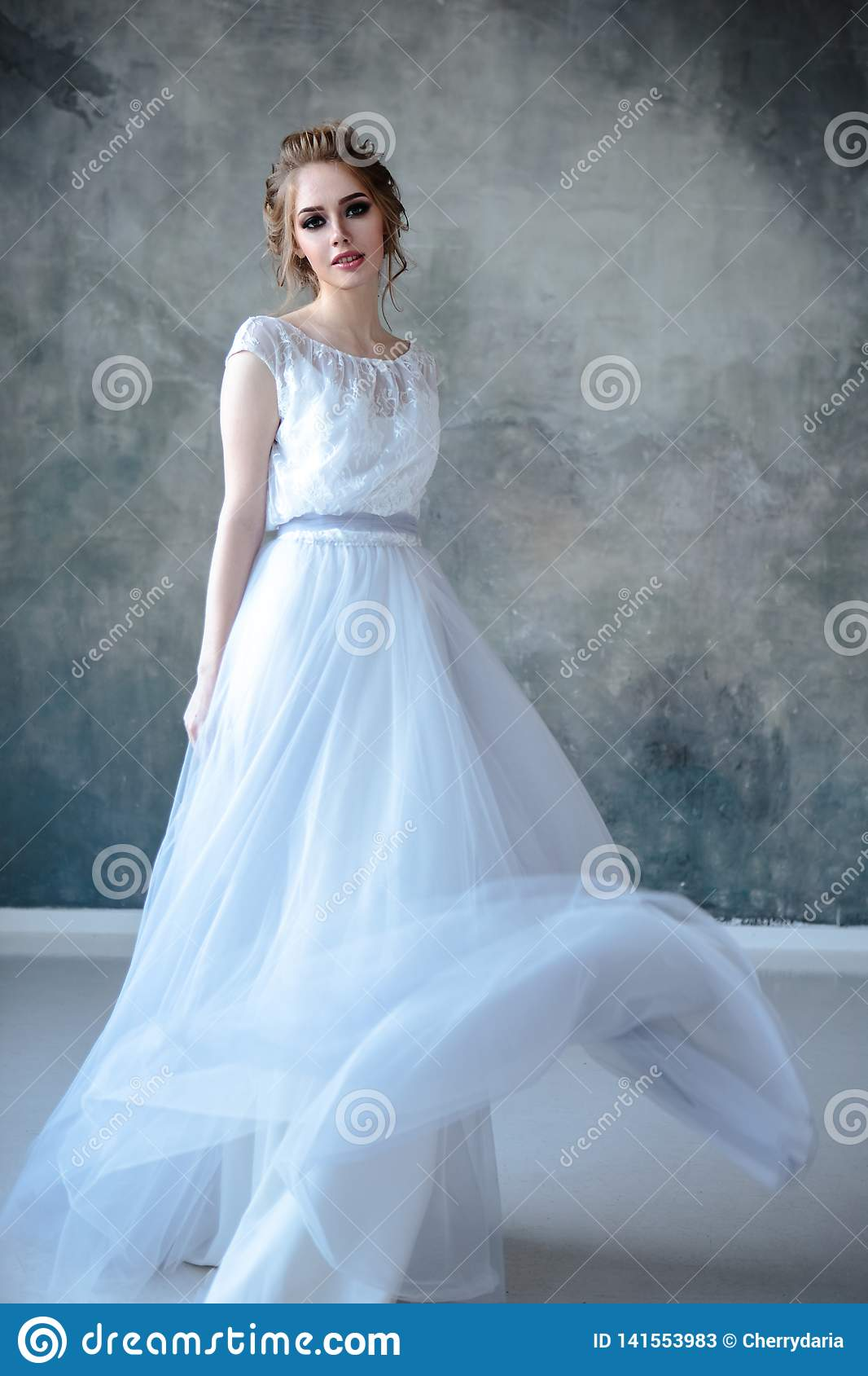 Bride Blonde Woman In A Modern Color Wedding Dress With Elegant