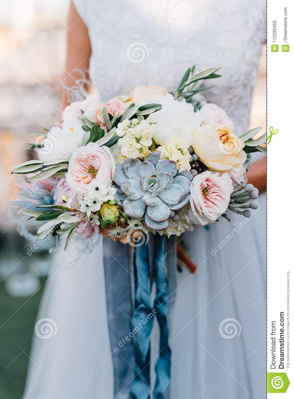 Bride In Blue Wedding Dress Holds Colorful Wedding Bouquet With ...