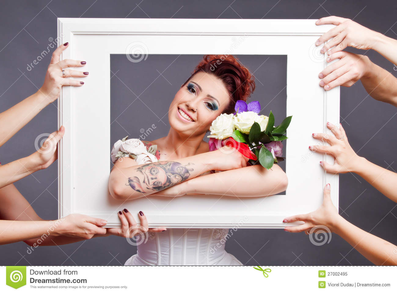 Bride with bouquet in frame
