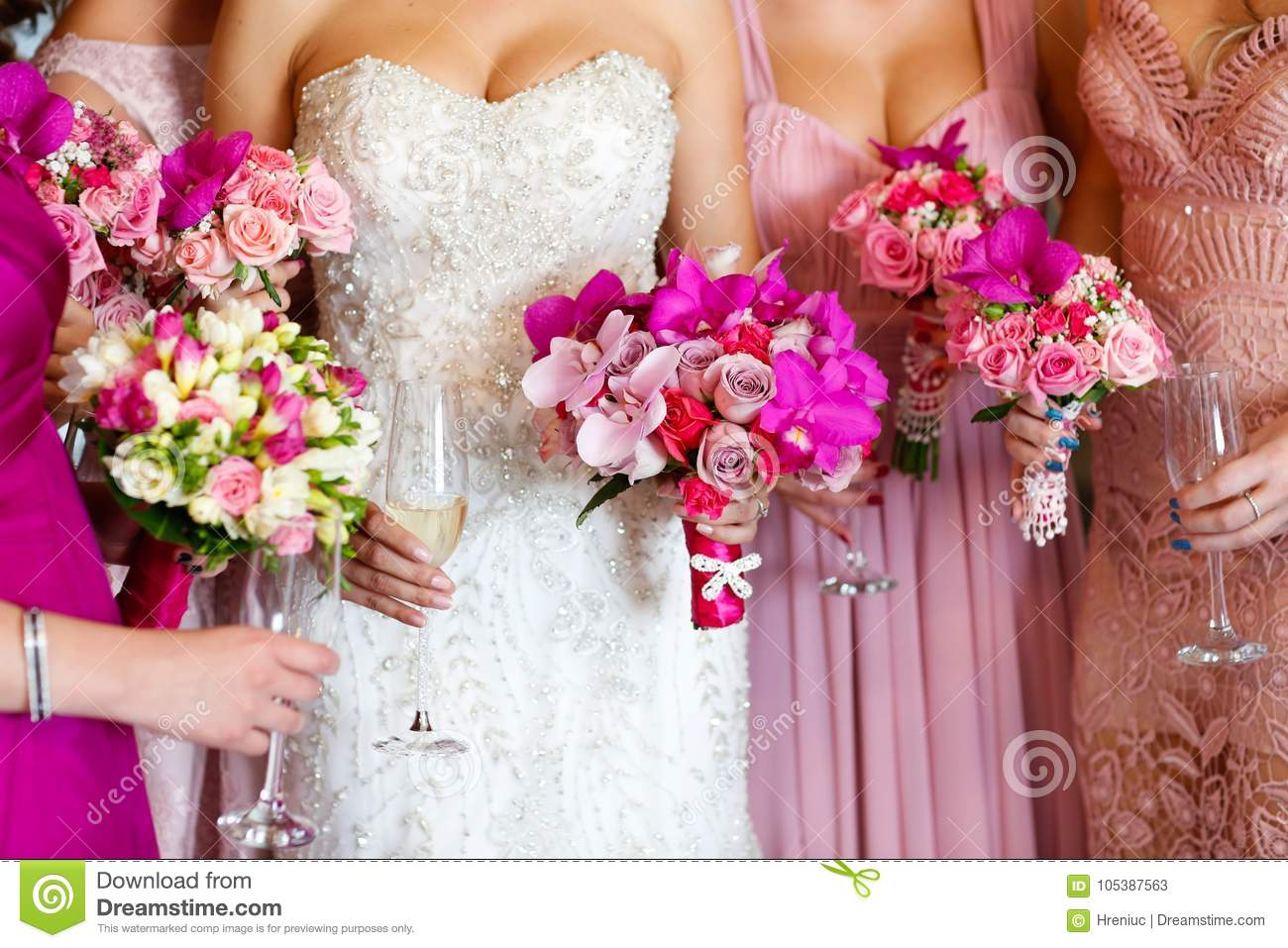 Bride With Bridesmaids Holding Beautiful Flower Bouquet Stock Image