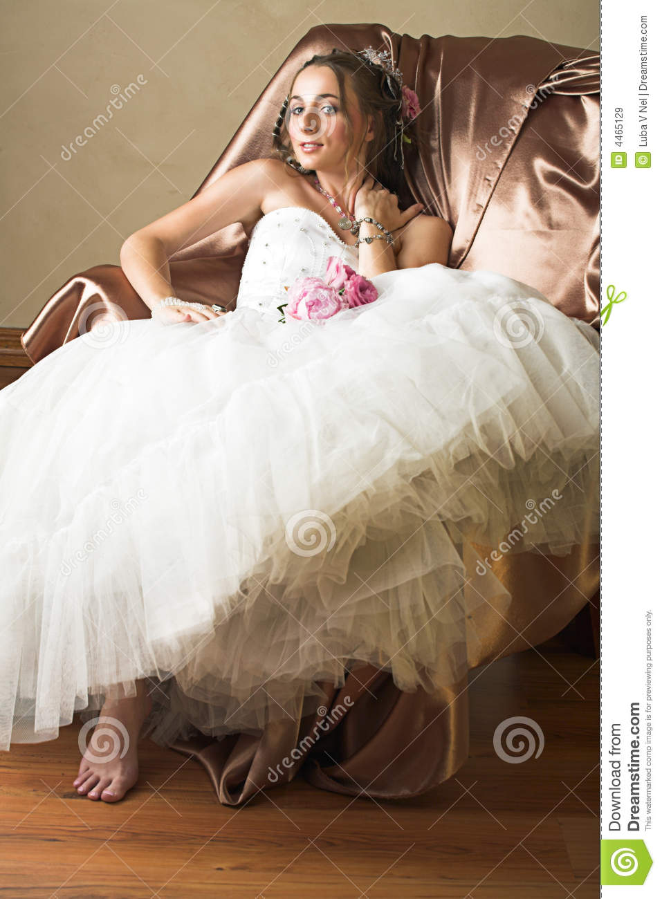 Bride With Brown Long Hair Sitting In Chair Royalty Free