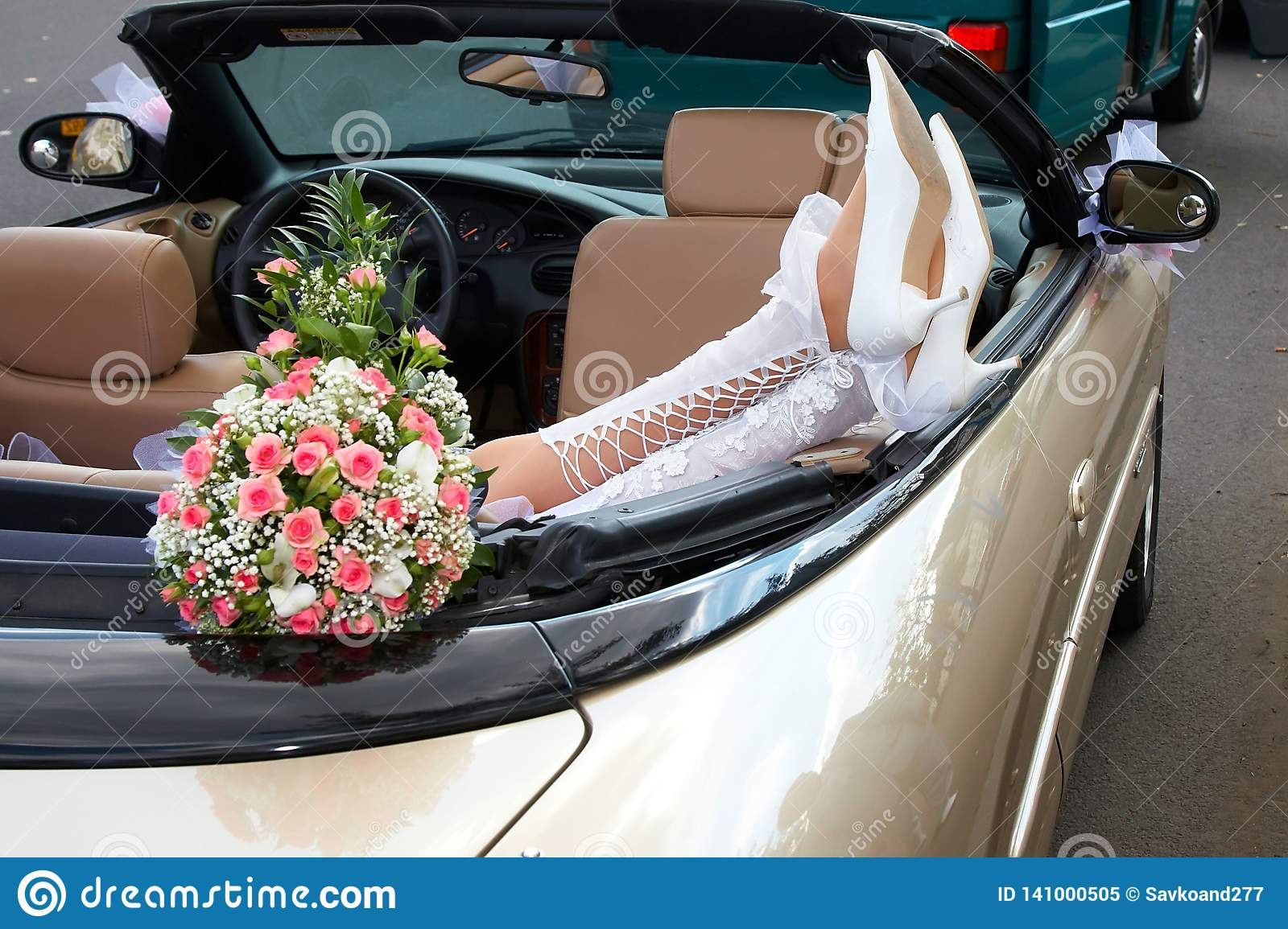 Bride in a cabriolet with flowers
