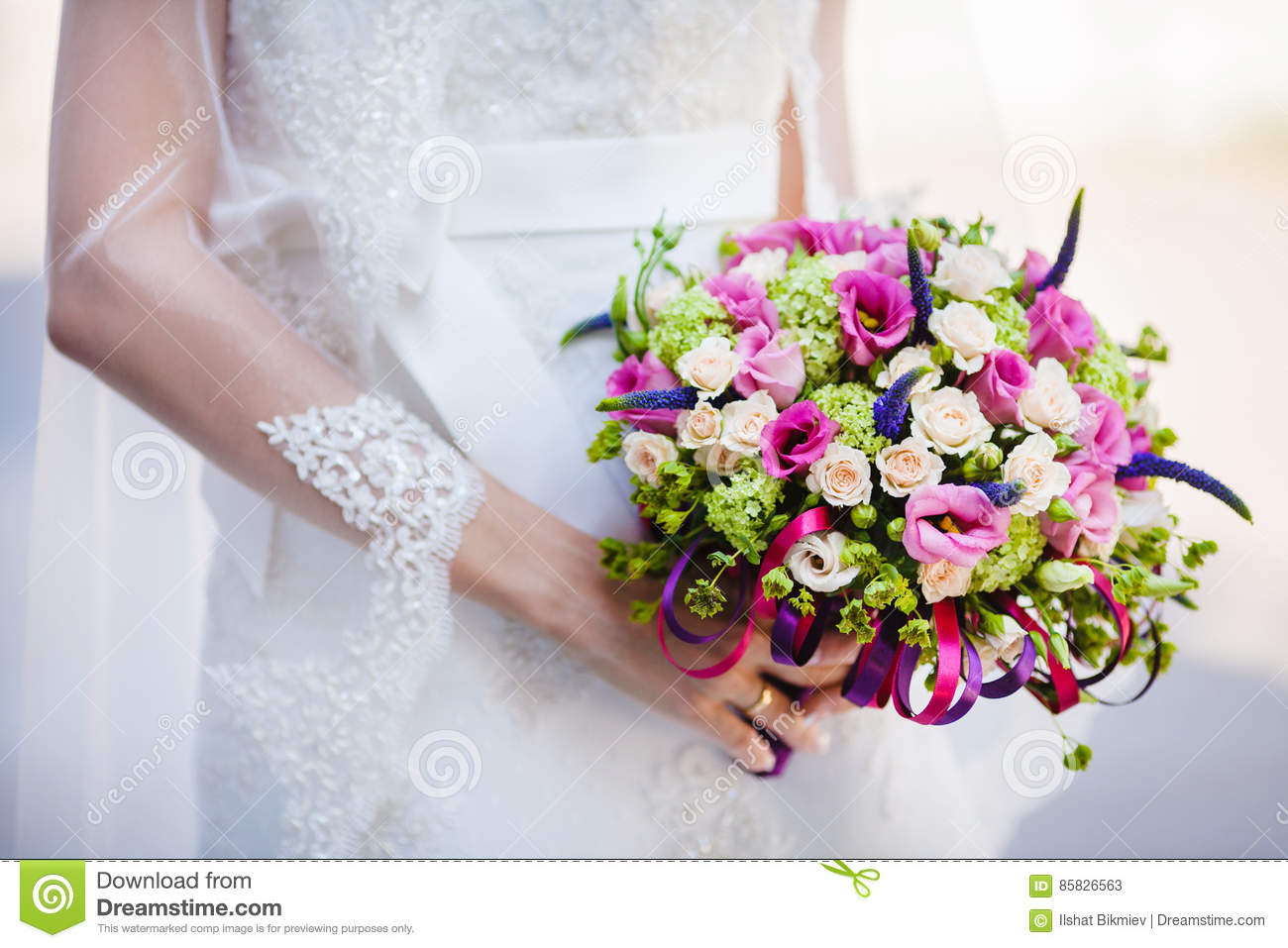 Bride In Dress And Bridal Veil Holds Wedding Bouquet Stock Image