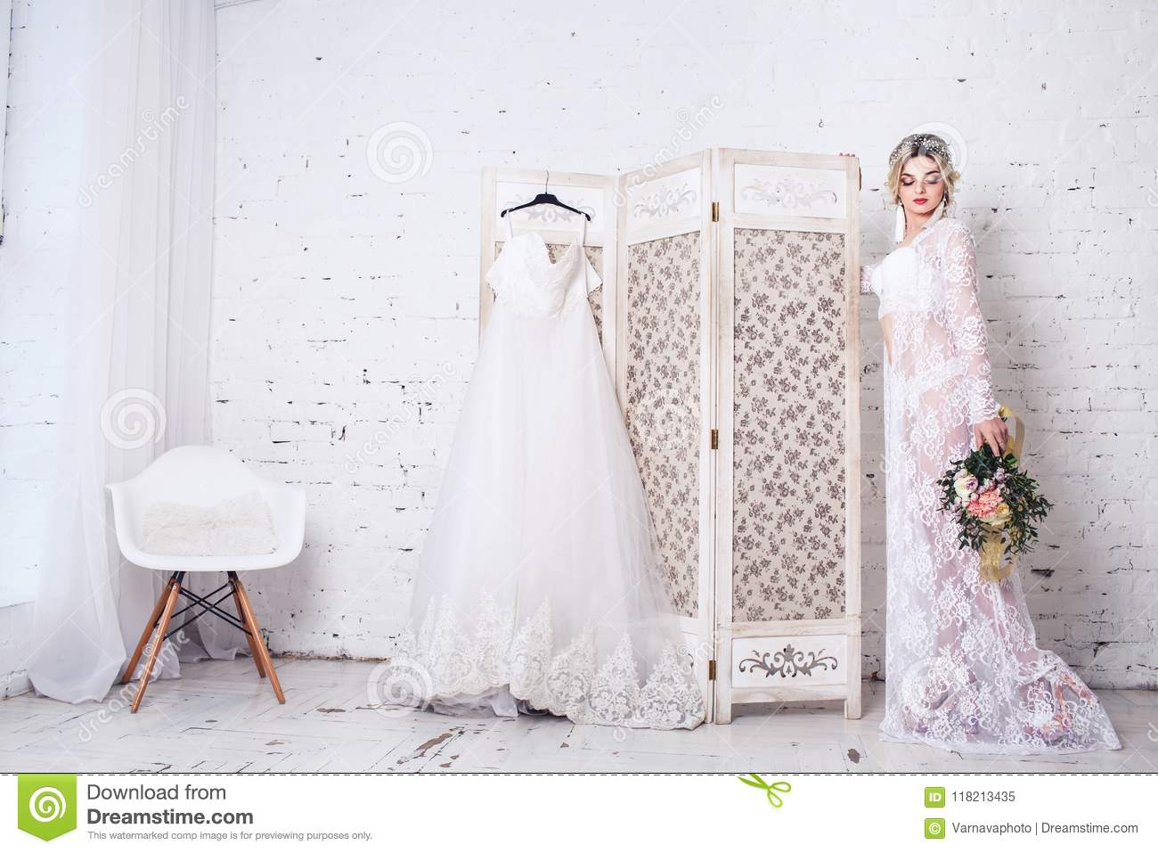 Bride Dressed In Peignoir And Underwear Stands Near Shield With