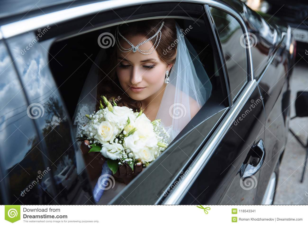 The Bride Is Dressed In A Wedding Dress And Veil Her Head Is Draped With A Lapel And Sits In The Car And Admires The Stock Image Image Of Luxurious Love