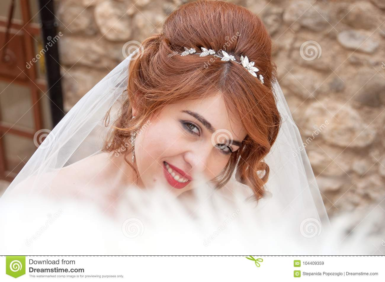 Bride With Fashion Wedding Hairstyle And Stylish Hair Accessory