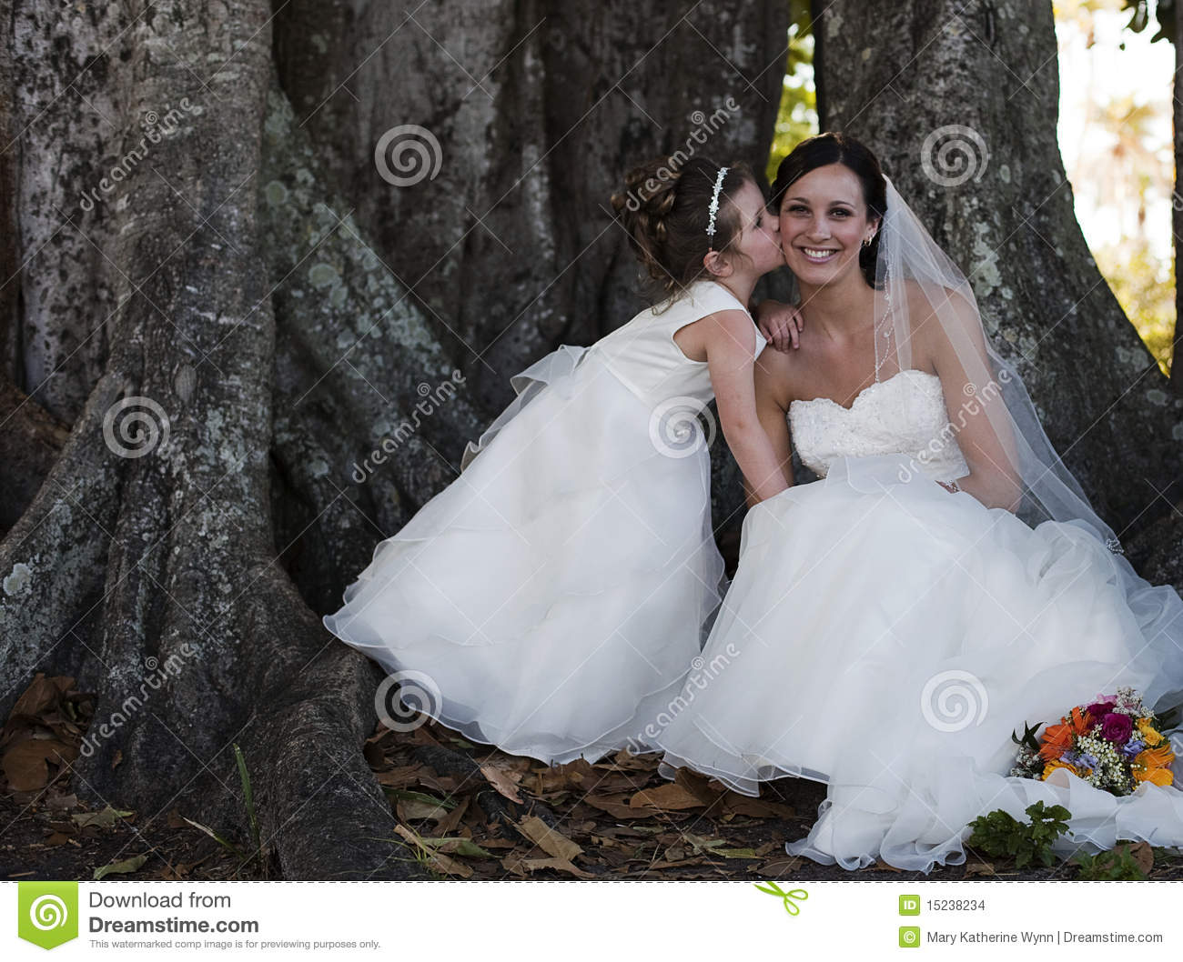 085775b48a92 Bride And Flower Girl Under Tree Stock Photo - Image of outdoors ...
