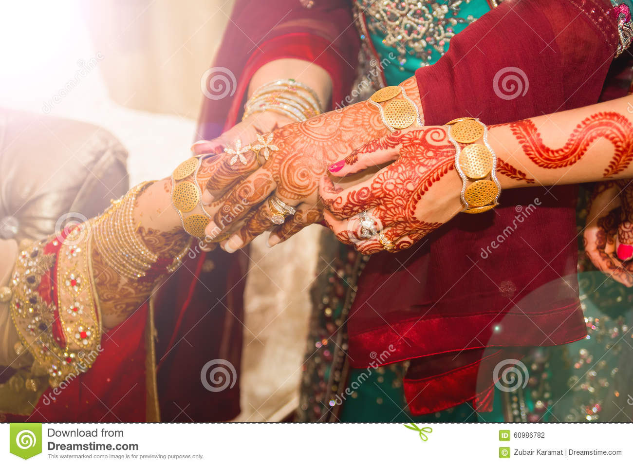 Indian Bride Receiving Gold Bangles As A Wedding Gift By The Grooms Mother And Sister Hands Showing Tattoos And Diamond Rings
