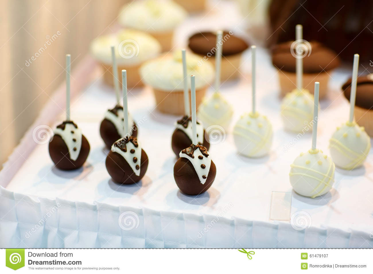 bride and groom wedding cake pops and groom cake pops for wedding sweet table stock 12123