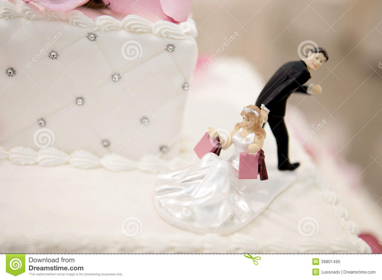 Bride And Groom Cake Toppers On A Wedding