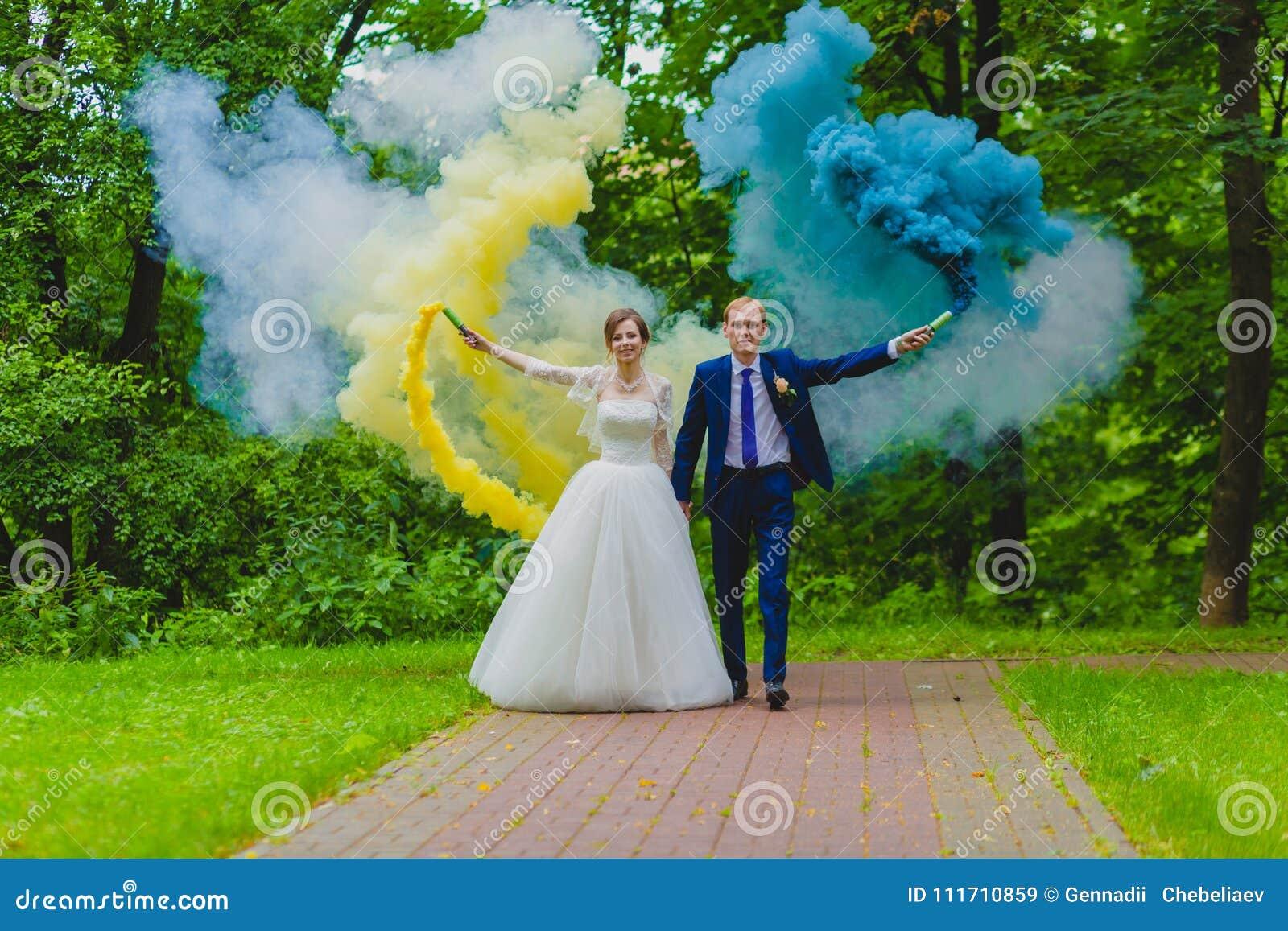 Bride And Groom With Colorful Smoke Bombs Stock Image
