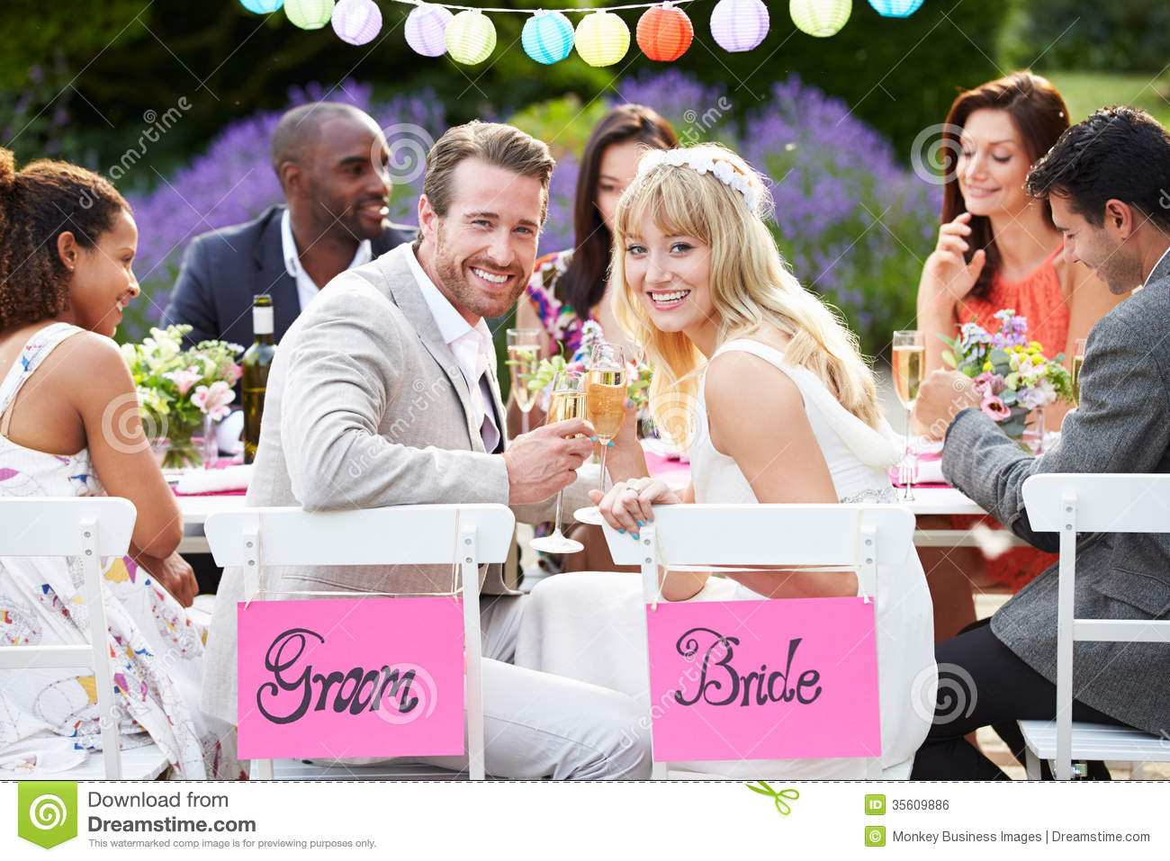 Indoor Wedding Venue Royalty Free Stock Photo: Bride And Groom Enjoying Meal At Wedding Reception Stock