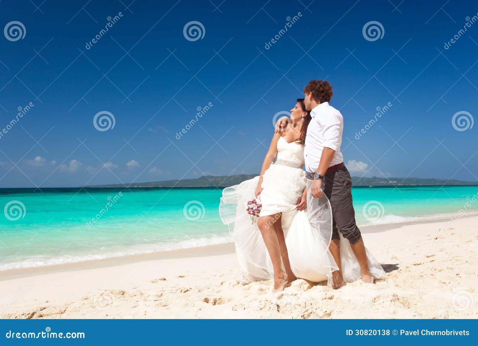 Bride And Groom Having Fun On Beach Royalty Free Stock Photos