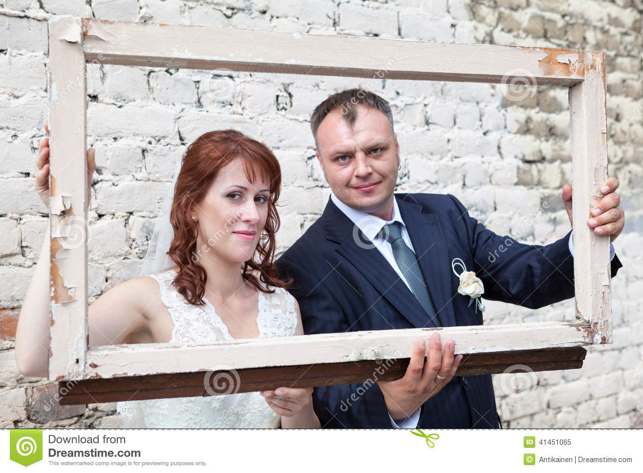 Bride And Groom Hold Portrait Frame Stock Image Image Of Looking