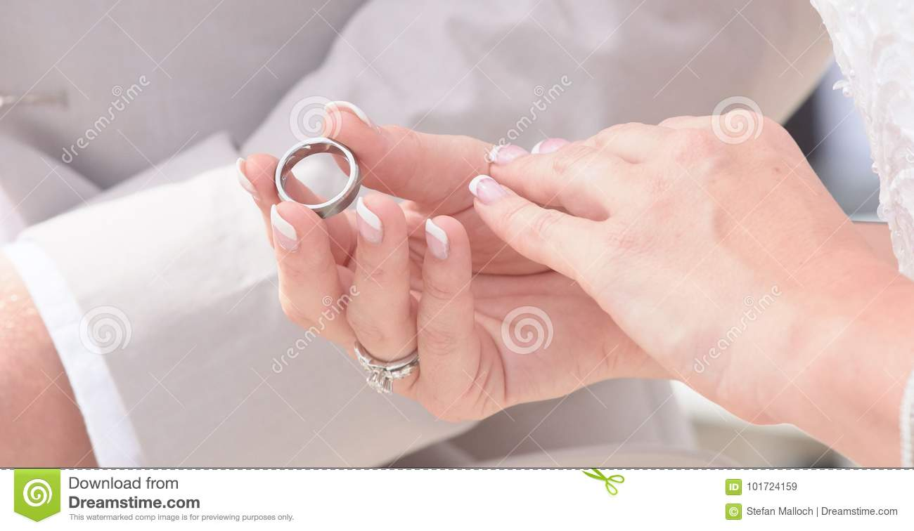 Bride And Groom Holding Hands And Exchanging Rings Stock Image ...