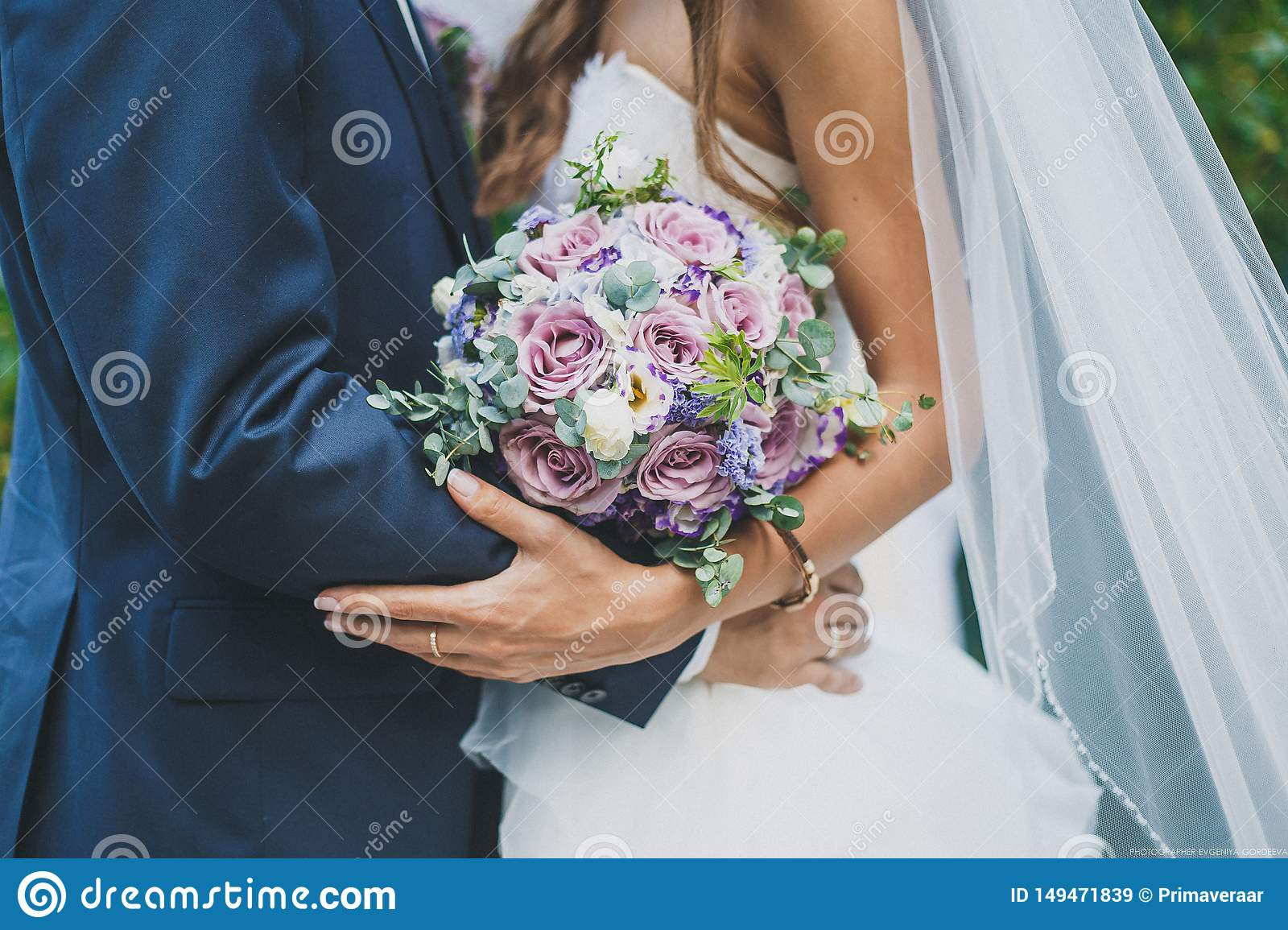 the bride and groom are holding a wedding bouquet
