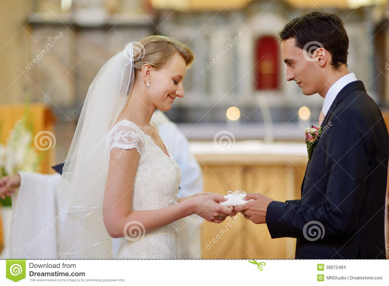 Bride And Groom Holding Wedding Rings Stock Photo