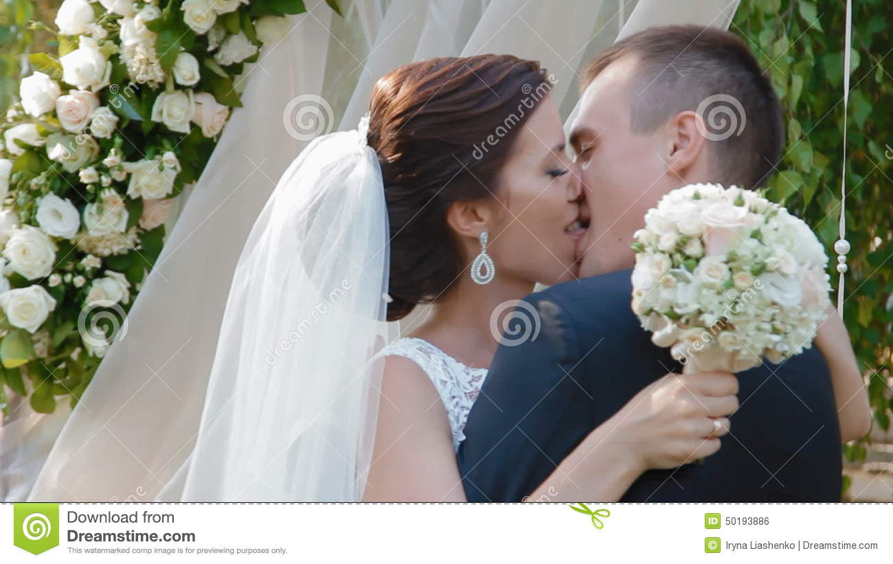 Bride And Groom Kiss For The First Time After Stock Footage - Video ...