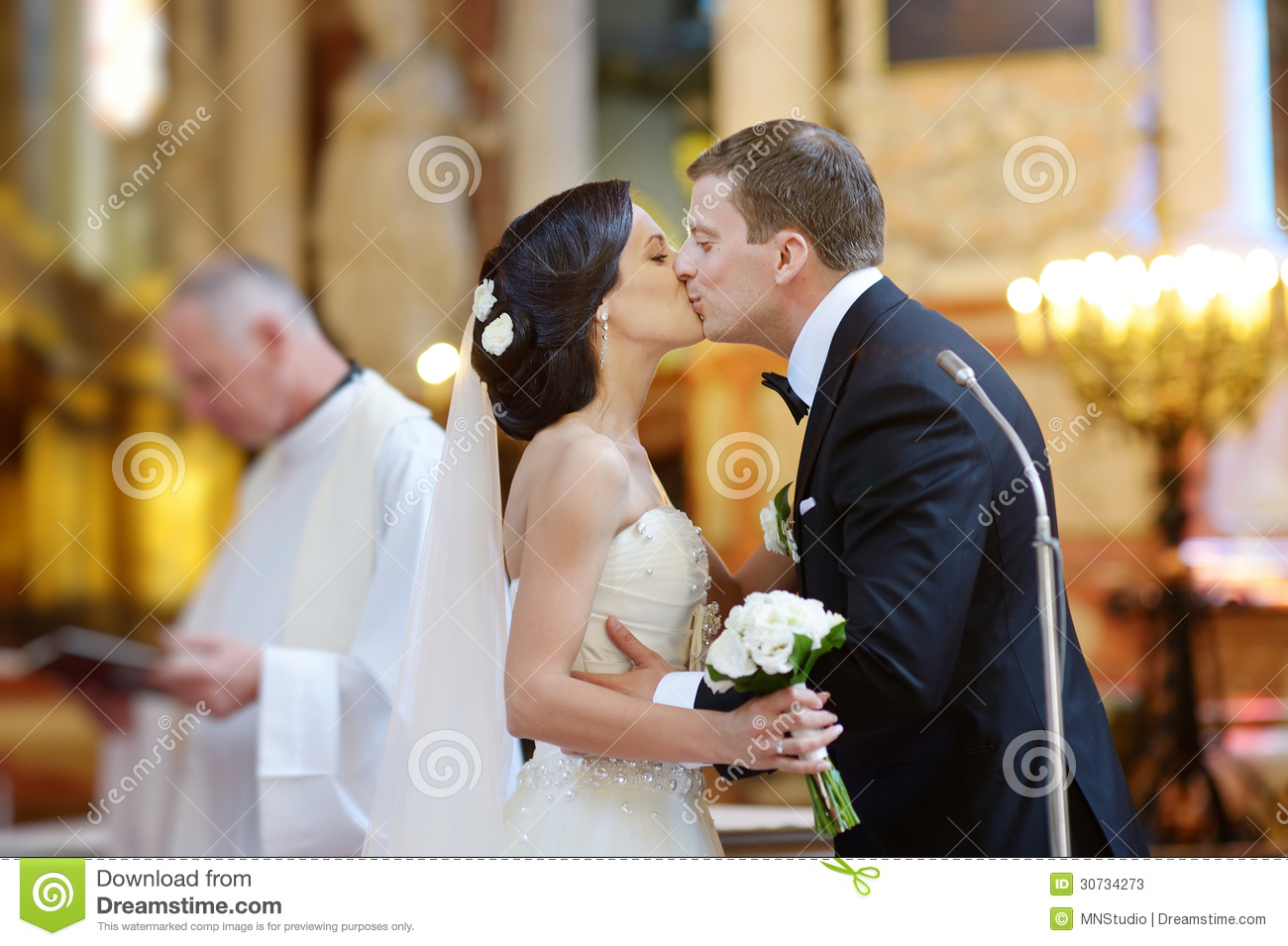 Bride and groom kissing in a church stock image image for Dress after wedding ceremony