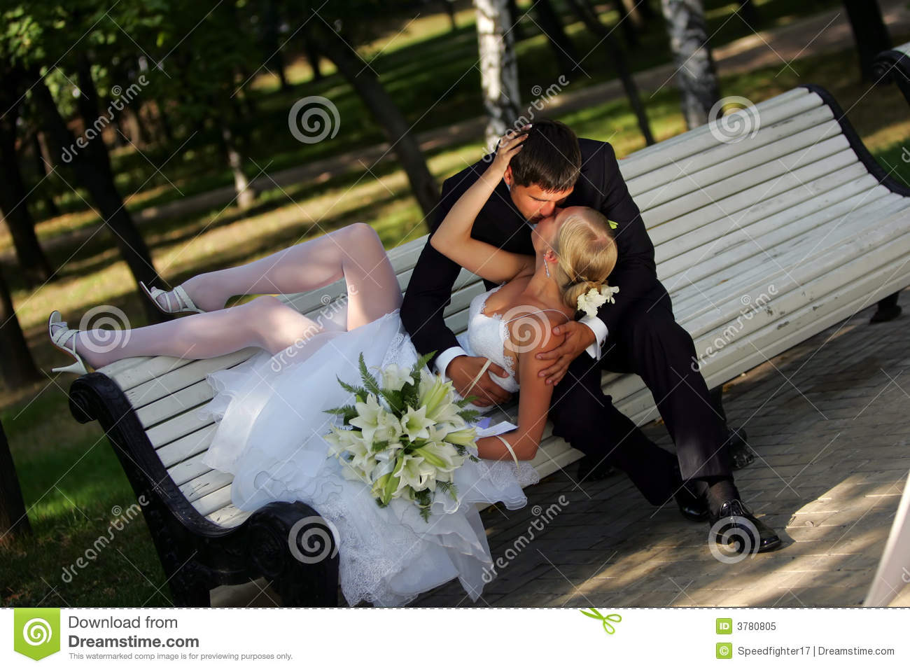 Bride And Groom Kissing On Park Bench Royalty Free Stock Photo - Image ...